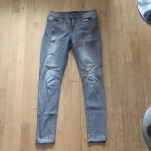Gray express jeans with rips